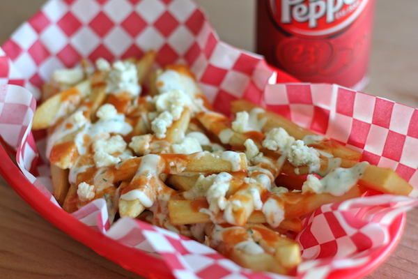 Buffalo Ranch Fries - Homemade french fries made to crisp perfection, topped with homemade Ranch dressing and buffalo sauce!