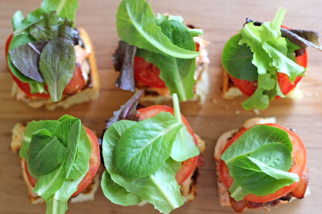 Salmon BLT Sliders with Chipotle Mayo - Loaded sliders with baked salmon and crisp bacon smothered in chipotle mayo.