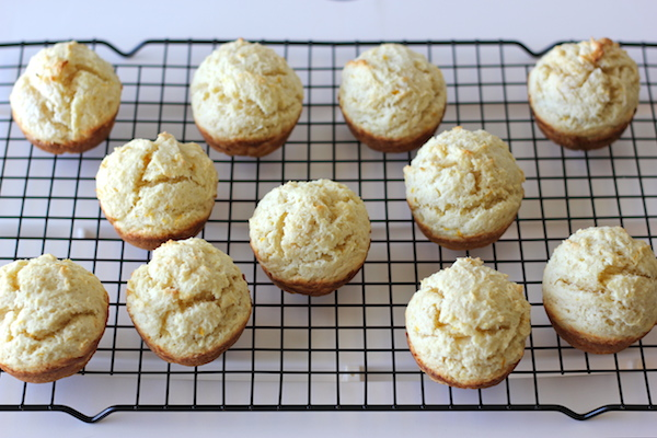 Orange Sour Cream Muffins with Zesty Orange Glaze - Start your mornings off right with these refreshing muffins with a decadent glaze!