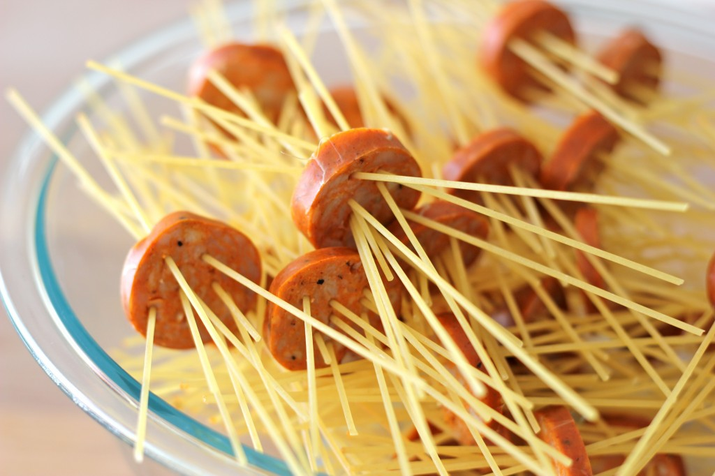 Threaded Spaghetti Hot Dog Bites with Homemade Marinara Sauce - These hot dog bites are so fun to make with both kids and grown-ups!