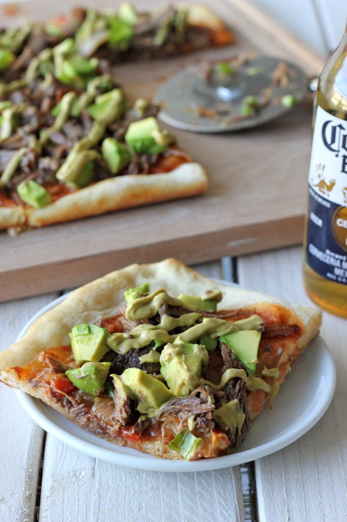 Carnitas Avocado Pizza - Pizza was meant to be smothered in slow-cooked, tender carnitas and drizzled with chipotle avocado mayo!