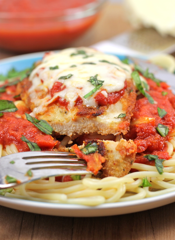 Baked Chicken Parmesan - A lighter version of the traditional chicken parmesan that's baked to absolute crisp perfection!