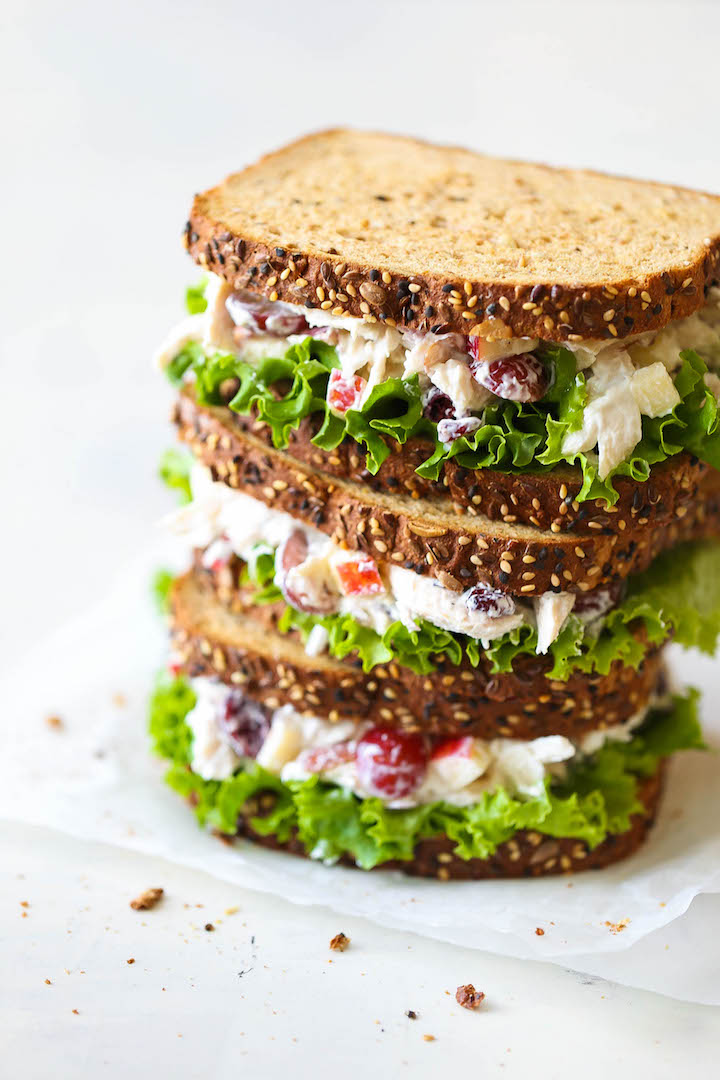 Greek Yogurt Chicken Salad Sandwich - From the plump grapes to the sweet cranberries, this lightened up sandwich won't even taste healthy! PROMISE!