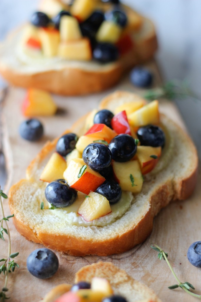 Goat Cheese Crostini with Blueberry and Peach Thyme Salsa - The flavors of summer come together for an elegant appetizer.