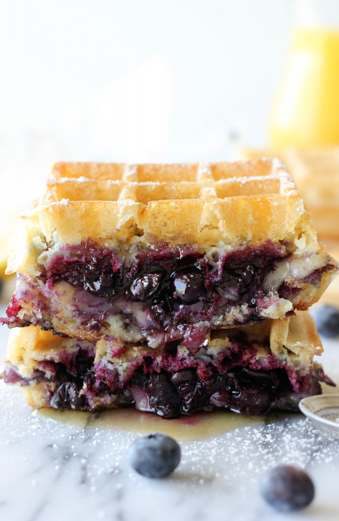 Brie and Blueberry Waffle Grilled Cheese - Two crisp buttermilk waffles sandwiching a blueberry compote with melted brie – the perfect grilled cheese for breakfast!