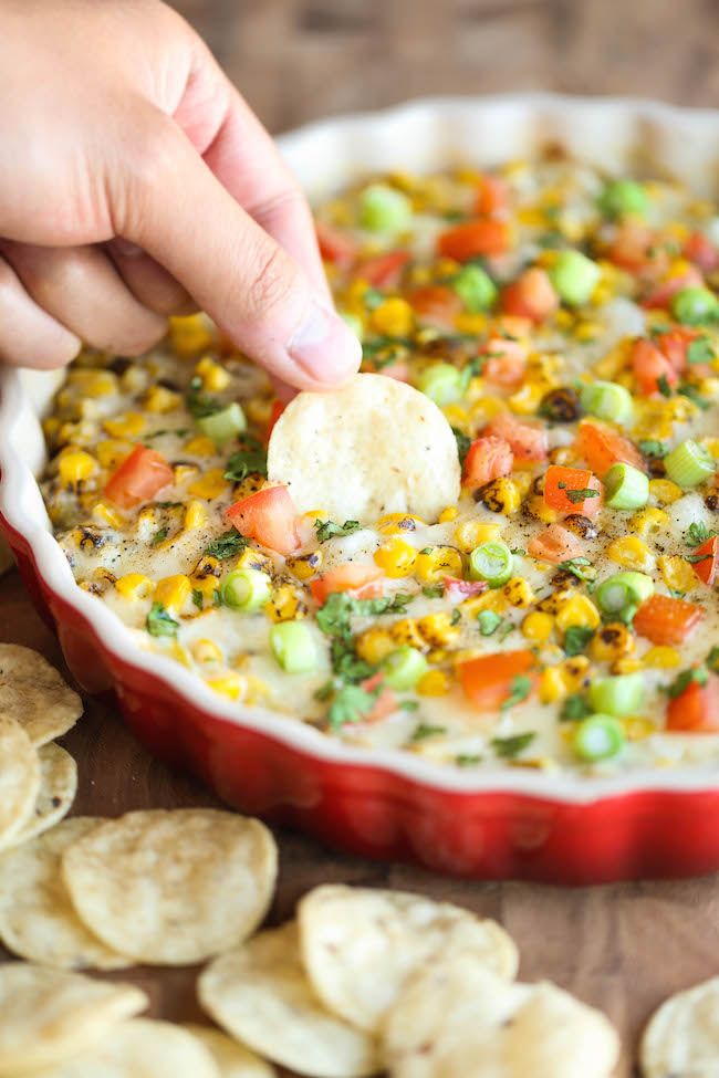 """Hot Cheesy Corn Dip - A super easy and amazingly creamy corn dip that comes together with just 10 min prep. And it's even made """"skinny"""" with Greek yogurt!"""