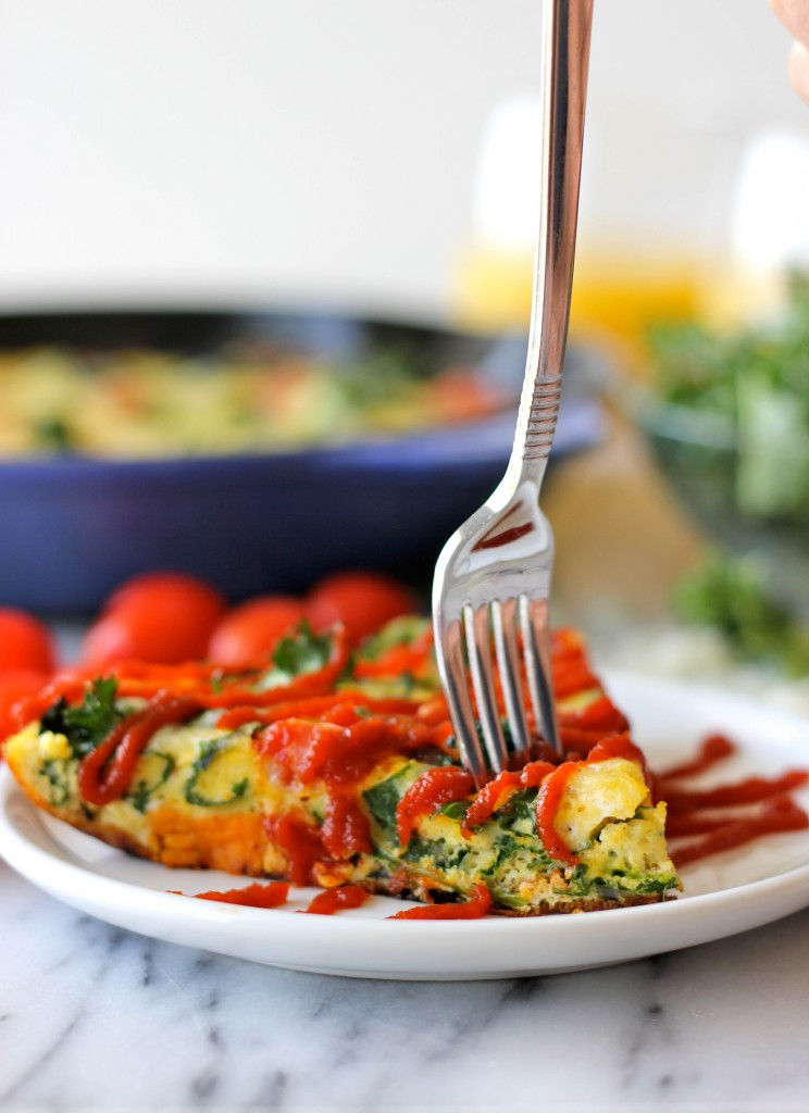 Sweet Potato Kale Frittata - Loaded with caramelized onions, tomatoes, kale and sweet potato goodness topped with melted mozzarella!