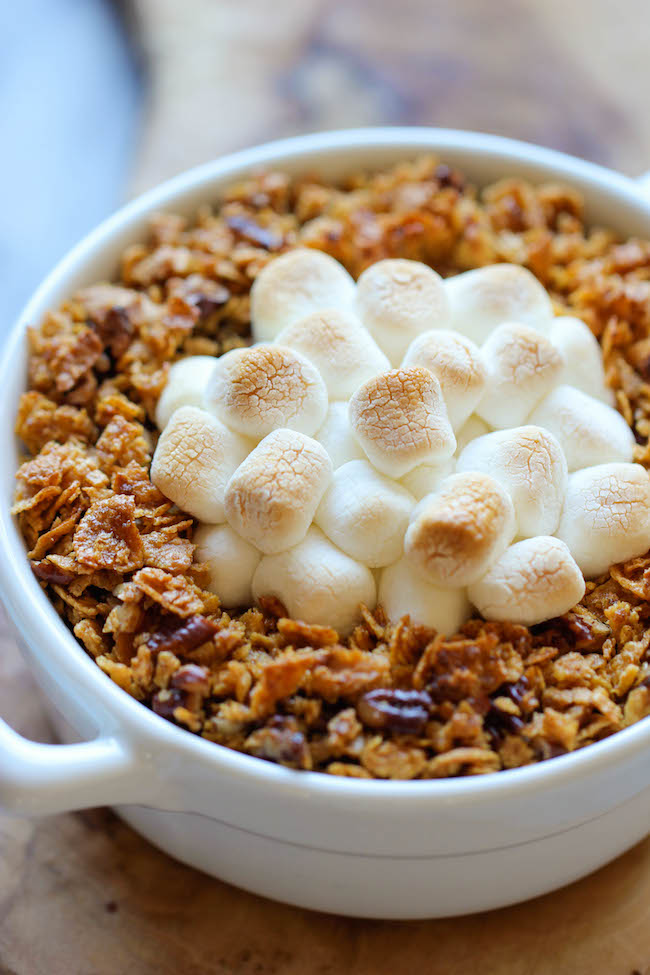 Sweet Potato Casserole - Made with mashed roasted sweet potatoes and a crunchy pecan topping with an ooey gooey melted marshmallow center!
