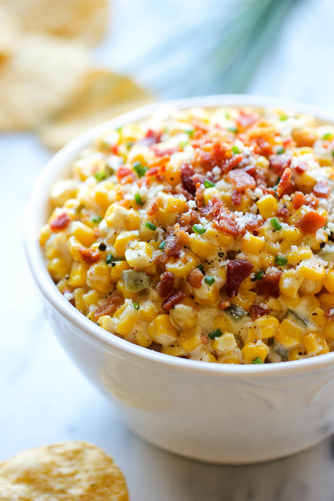 Slow Cooker Corn and Jalapeño Dip - Simply throw everything in the crockpot for the easiest, most creamiest dip ever!