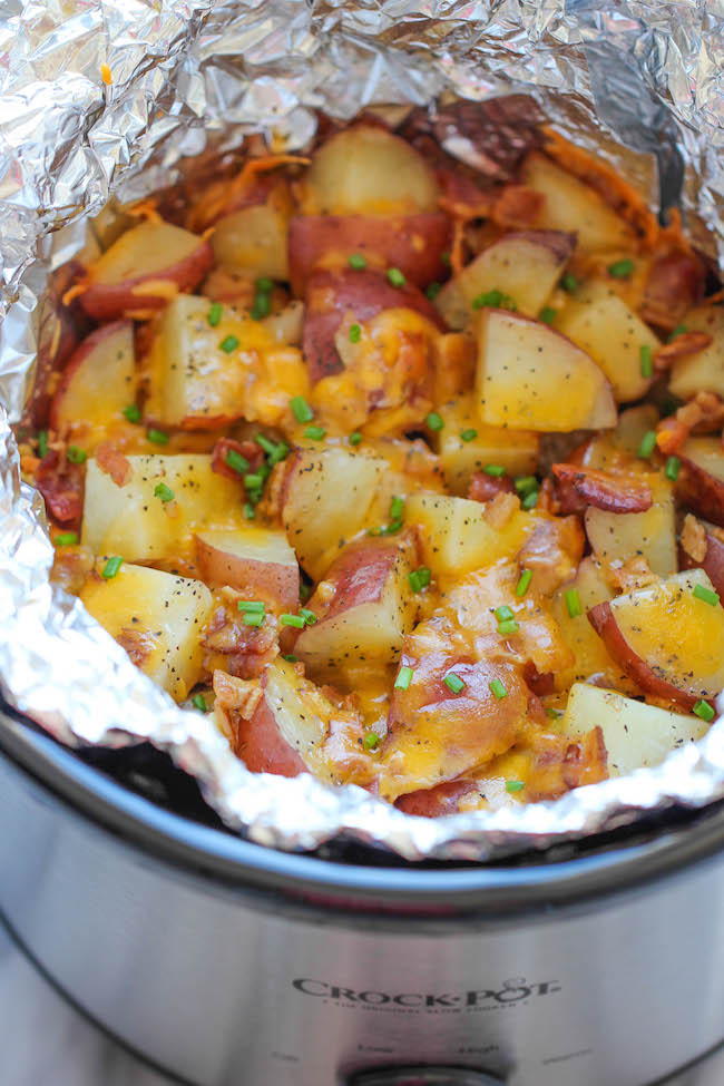 Slow Cooker Cheesy Bacon Ranch Potatoes - The easiest potatoes you can make right in the crockpot – perfectly tender, flavorful and cheesy!