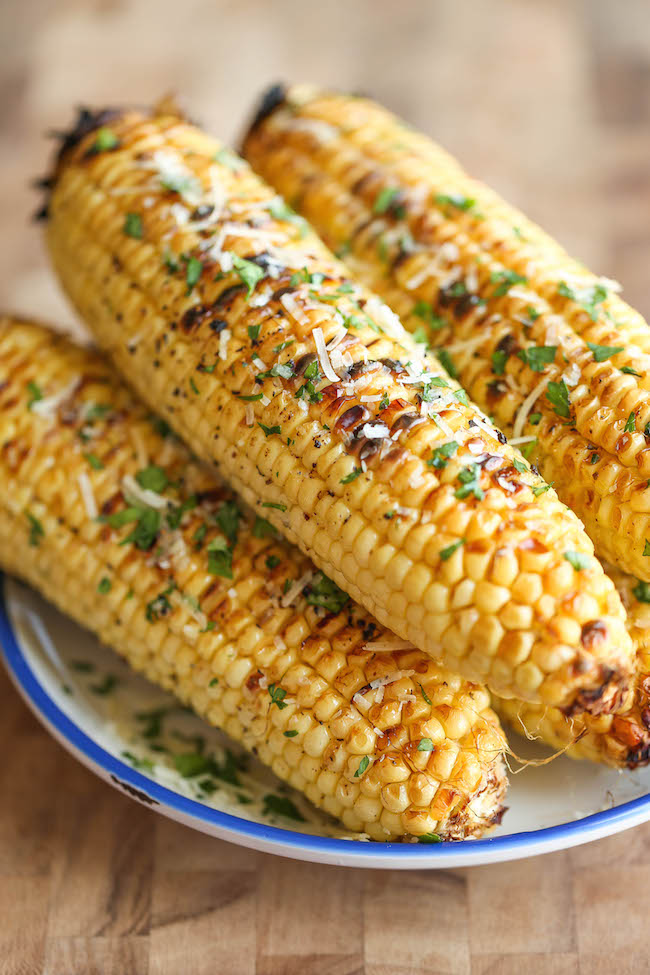 Parmesan Corn on the Cob - So buttery, garlicky and loaded with Parmesan cheese goodness - grilled (or roasted) to absolute perfection!