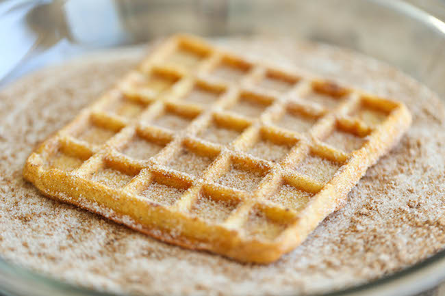 Pumpkin Churro Waffles - Light, fluffy, melt-in-your mouth pumpkin waffles coated in buttery cinnamon sugar and drizzled with a cream cheese glaze! Amazing.