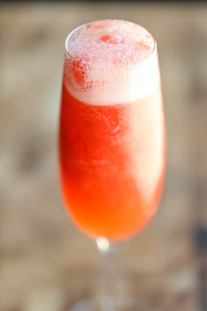 Strawberry Lemonade Bellini - This is a fun twist to your traditional peach bellini, made into a boozy-type slushy using only 4 ingredients with 5 min prep!