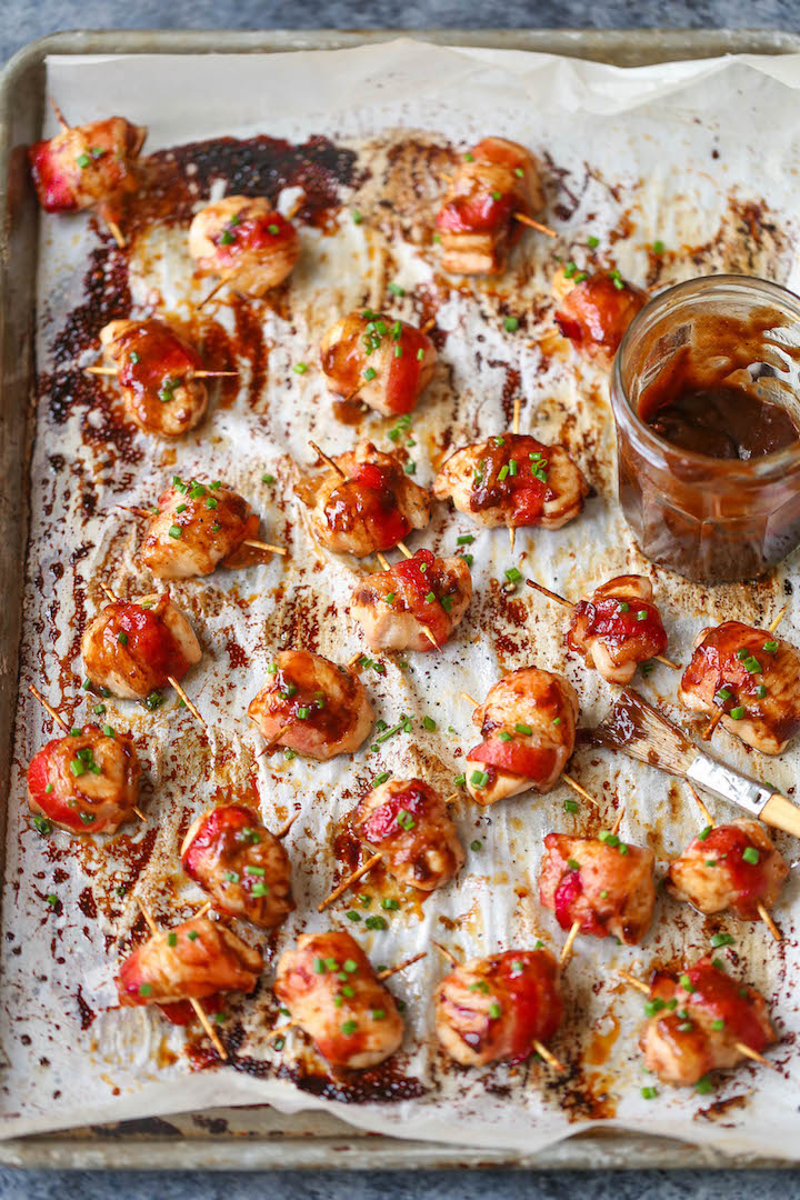 BBQ Chicken Bites - The best crowd-pleasing chicken bites wrapped in crisp-tender bacon and smothered in a smoky-sweet BBQ sauce!
