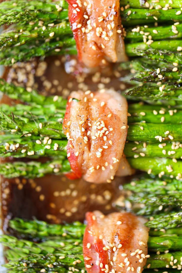 Bacon Wrapped Asparagus - Asparagus bundles wrapped in crisp-tender bacon in a buttery brown sugar glaze - grilled or baked! Can be prepped in advance!