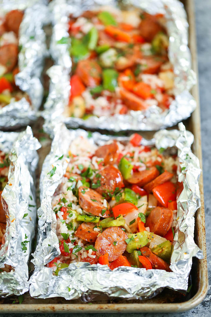 Sausage and Peppers Foil Packets - Prep ahead of time and portion these into individual servings! Loaded with sausage, peppers, rice and cajun seasoning!!!