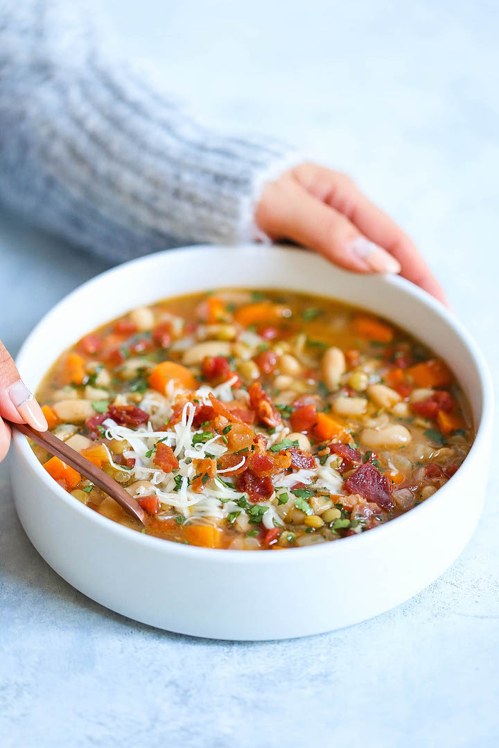 Hearty Lentil and White Bean Soup - So hearty, healthy and easy with just 213 calories per serving! You can also make this on any given weeknight, and the leftovers reheat very well! With the Parmesan rinds, this soup is bursting with just so much flavor!
