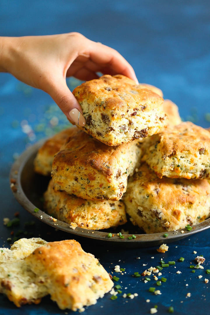 Sausage Cheese Biscuits - The most amazing breakfast biscuits ever! Loaded with fresh crumbled sausage chunks, sharp cheddar cheese and green onions. You will want this for breakfast every single morning!