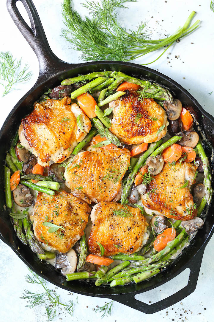Skillet Chicken with Creamy Spring Vegetables - One pan winner winner chicken dinner! The chicken comes out amazingly crisp tender with carrots, mushrooms and asparagus all cooked in the best herb cream sauce!
