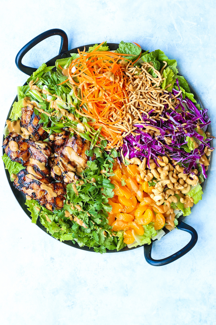 Asian Chicken Salad - With perfectly juicy, tender teriyaki chicken and the most amazing peanut dressing ever! It's quick, simple and perfect for a crowd!