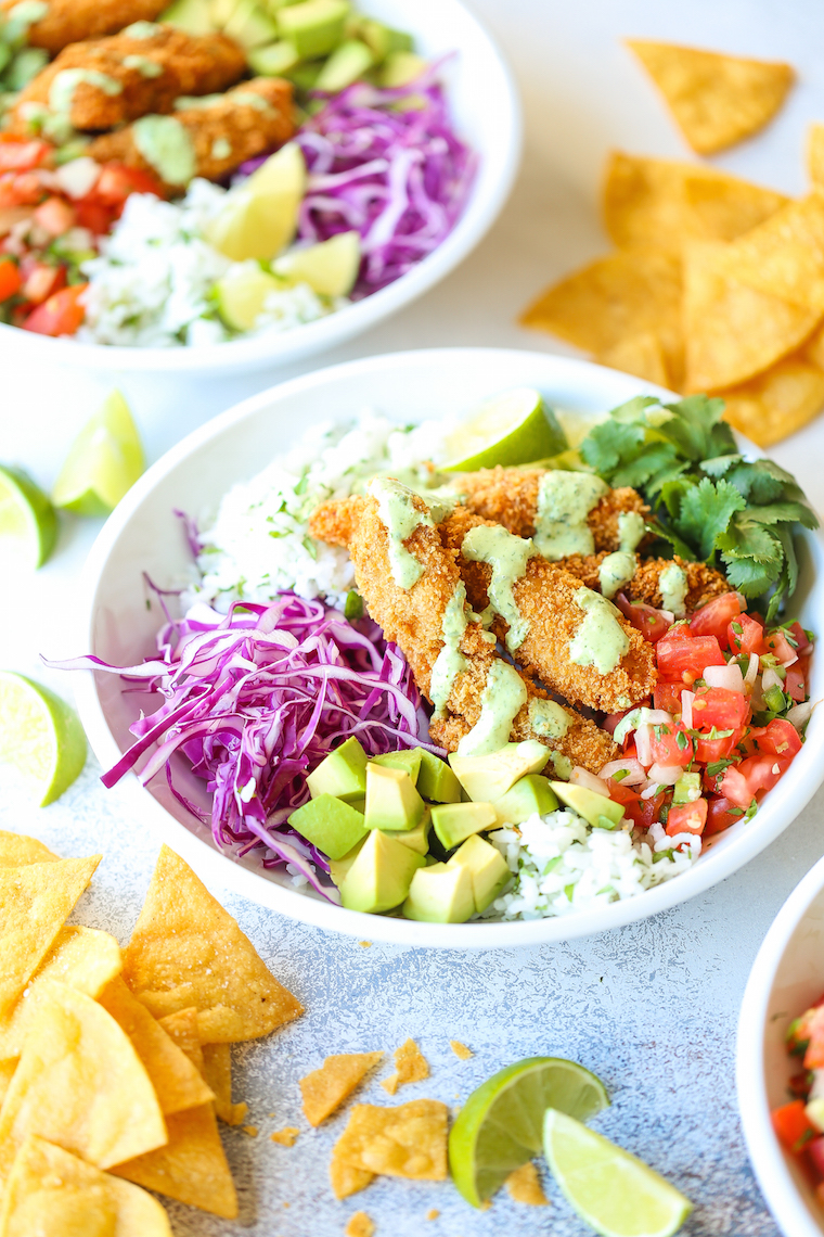 Fish Taco Bowls - The best weeknight meal! With perfectly cooked fish, cilantro lime rice, pico de gallo, avocado, and THE MOST epic cilantro lime dressing!