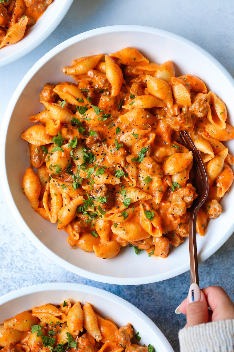 Creamy Red Pepper Shells - Crumbled Italian sausage, Parmesan, basil, and the most EPIC red pepper cream sauce. It's irresistible and completely addictive!