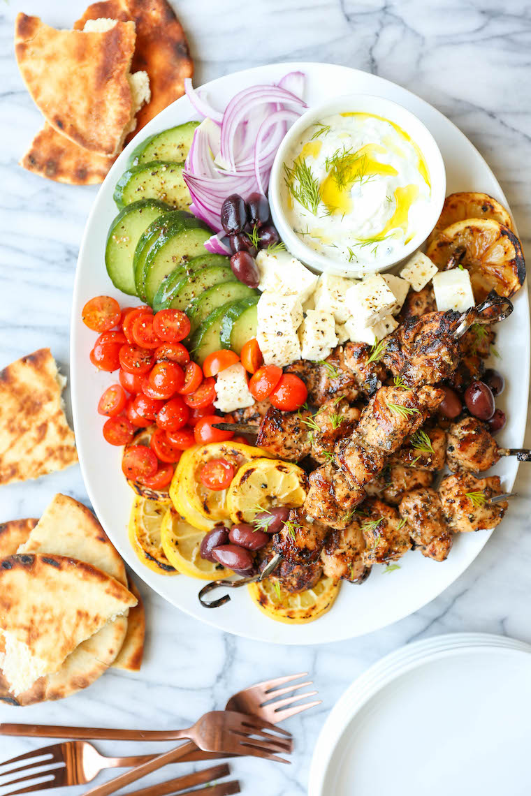 Greek Chicken Kabobs - Super juicy, tender kabobs made with the best marinade ever! Olive oil, lemon juice, paprika, oregano, basil, thyme, garlic. SO BOMB.