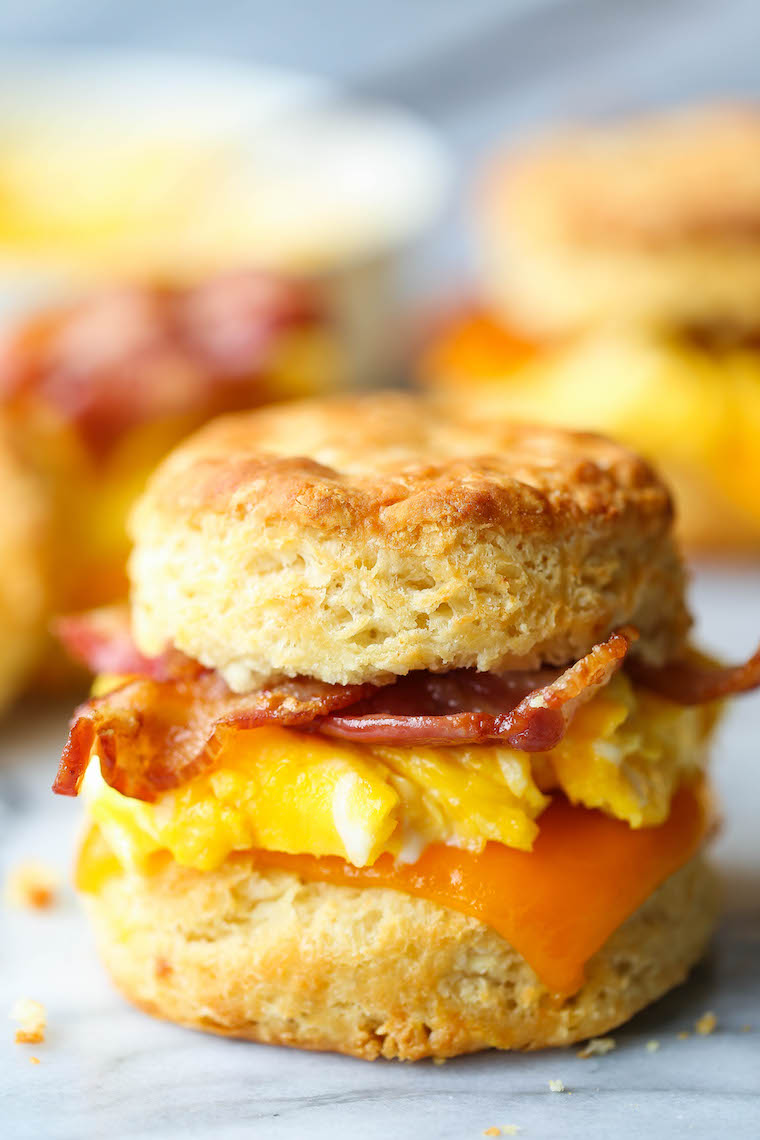 Make Ahead Breakfast Biscuit Sandwiches - Oh-so-warm, flaky buttermilk biscuits with eggs, bacon and cheese. Store in the fridge and reheat in the morning!