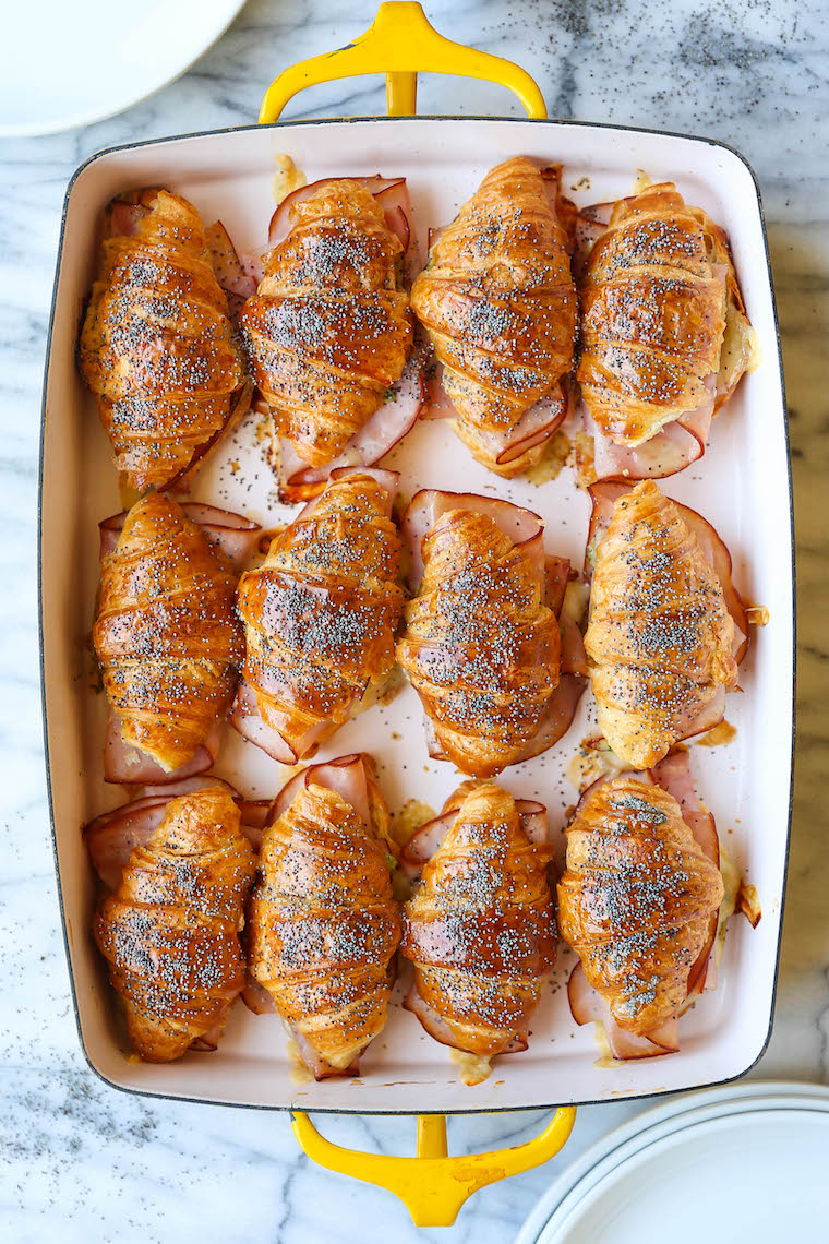 Baked Ham and Cheese Croissants - So so easy to make for a crowd! The mini croissants are toasted and flaky, baked with Dijon-honey, buttery goodness. WHOA.