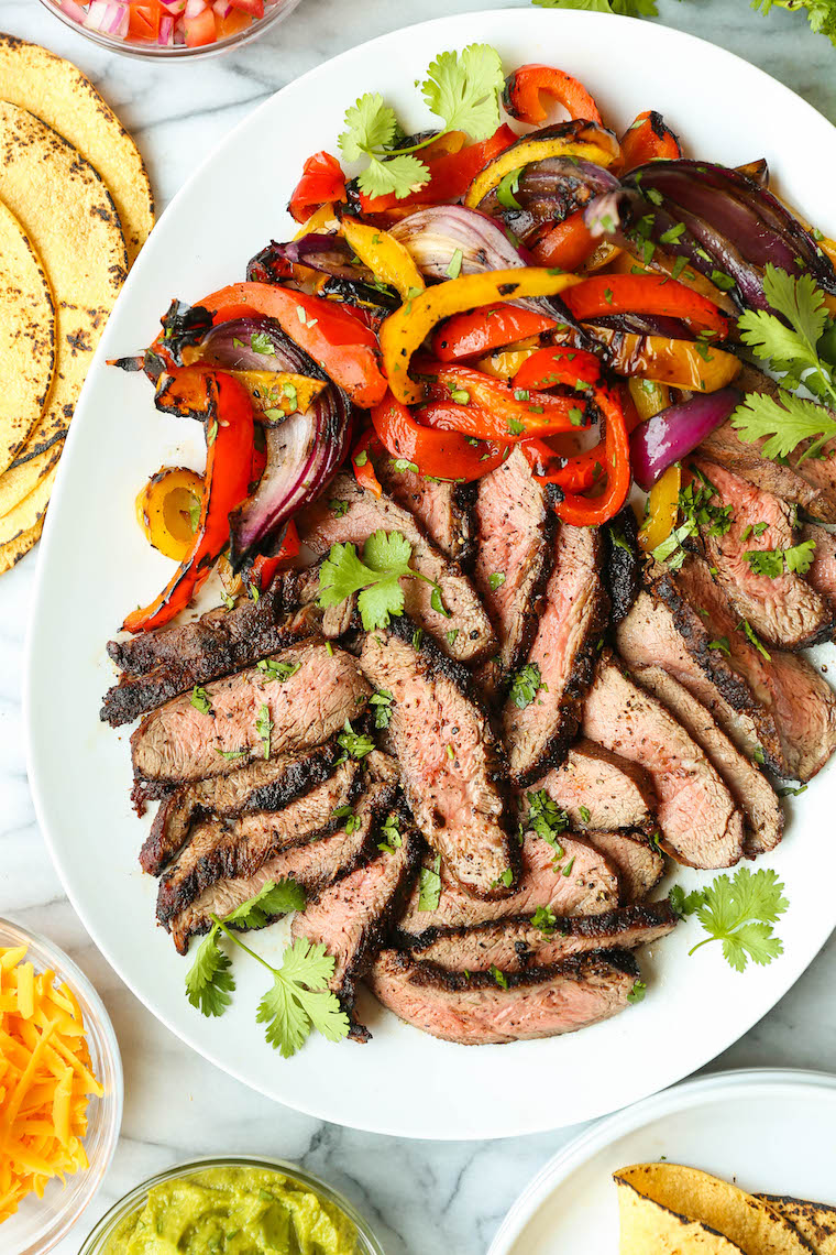 Easy Steak Fajitas - Tender, juicy, melt-in-your-mouth slices of steak with bell peppers and onion. SO SO GOOD. Serve with tortillas, pico and guacamole.