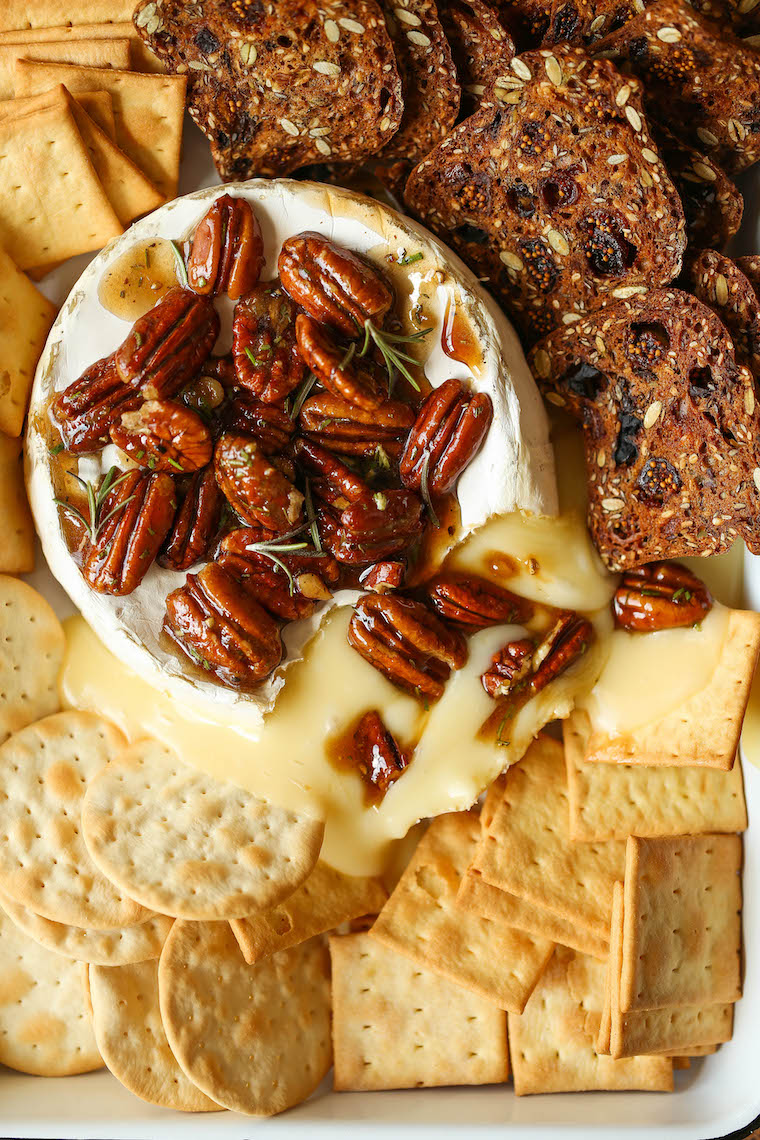Maple Pecan Baked Brie - The easiest 5-ingredient baked brie! Served with a heavenly warm maple pecan mixture on top. SO GOOD and an absolute crowd-pleaser.