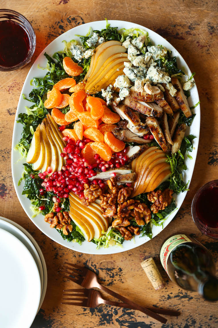 Winter Pear Salad - So hearty with so many feel-good ingredients! With lemon rosemary chicken, brussels sprouts, pear + a honey dijon dressing. YES, PLEASE!