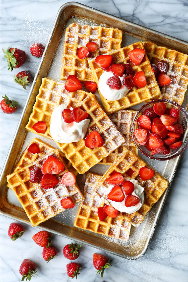 Strawberries and Cream Buttermilk Waffles - The waffles are perfectly fluffy and so light! SO GOOD. Topped with fresh strawberries + homemade whipped cream!