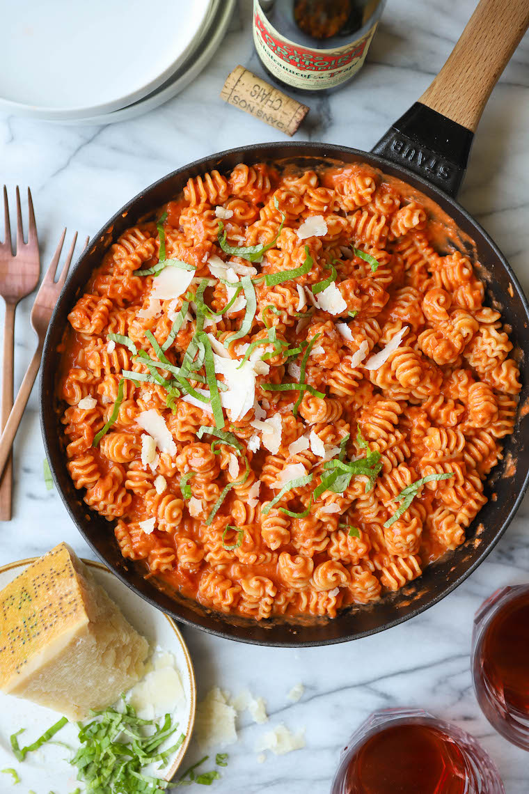 Vodka Sauce - Amazingly creamy, so bright, and super quick + easy. Comes together in 30 min! Serve with additional fresh Parmesan. SO SO GOOD.