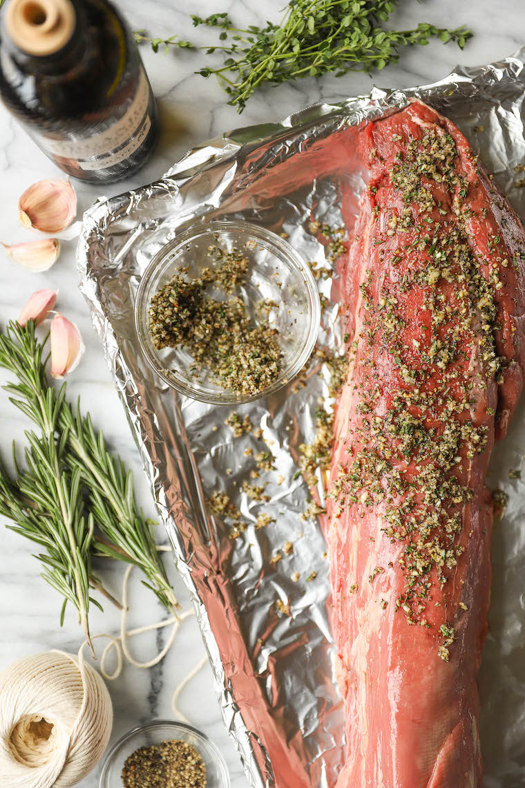 Garlic Rosemary Beef Tenderloin - Cooked low + slow, this is the most perfect (and only way to cook) tenderloin! So easy, so tender, so good.