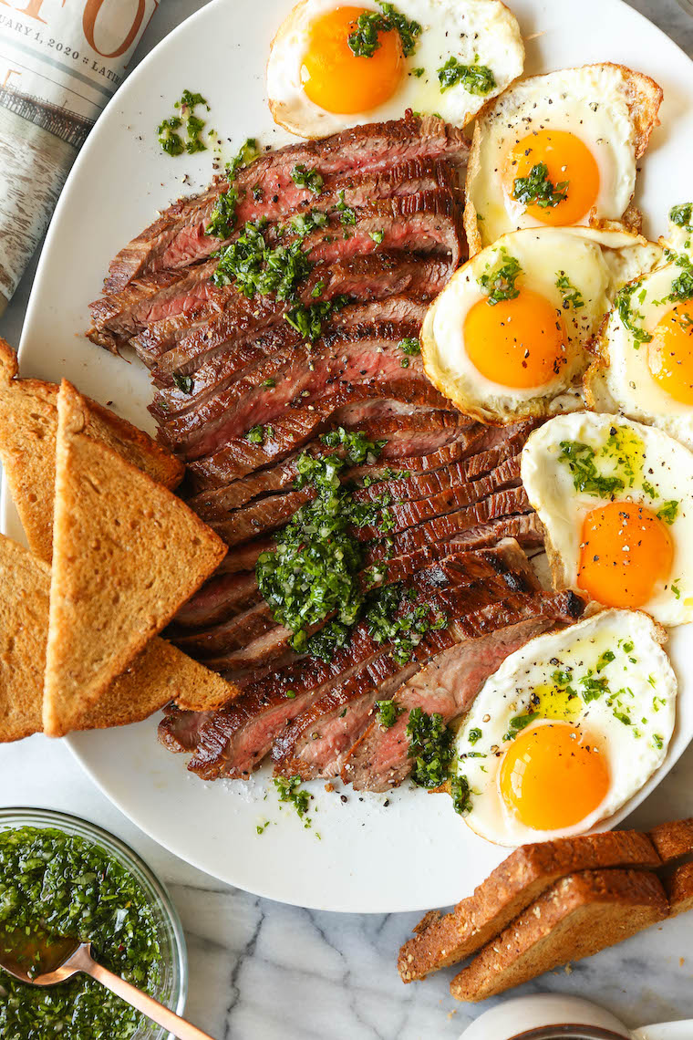 Best Ever Steak and Eggs - So quick, easy, and fancy pants without any of the hard work! Served with the most amazing herb sauce. SO SO GOOD.