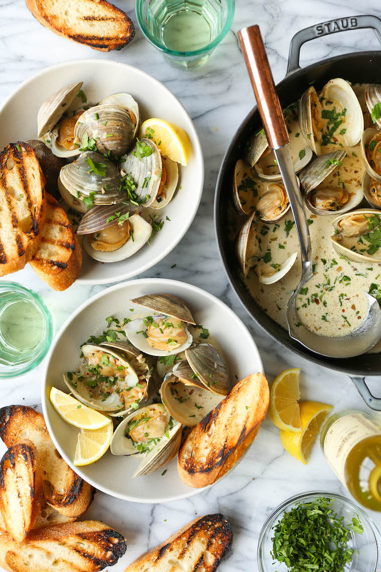 Garlic Butter Clams with White Wine Cream Sauce - The BEST steamed clams ever! So garlicky and buttery, served with a heavenly cream sauce!