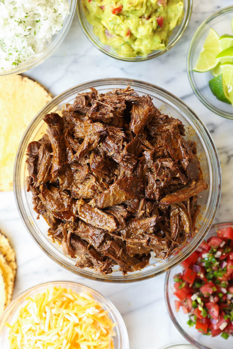 Slow Cooker Beef Barbacoa - So easy and so tasty!  Cooked low + slow in the slow cooker.  Perfect for tacos, burritos, quesadillas and more!